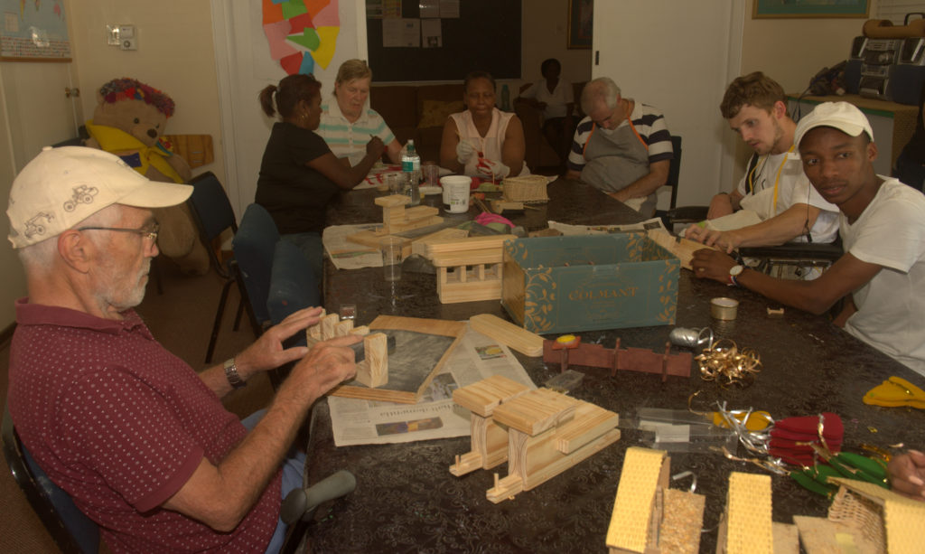 Members and carers preparing for the Headway-Natal 2018 craft market.